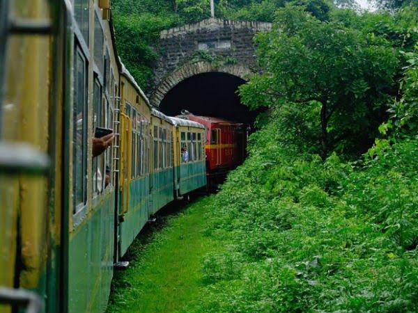 Toy train from Kalka to Shimla going through a dark tunnel