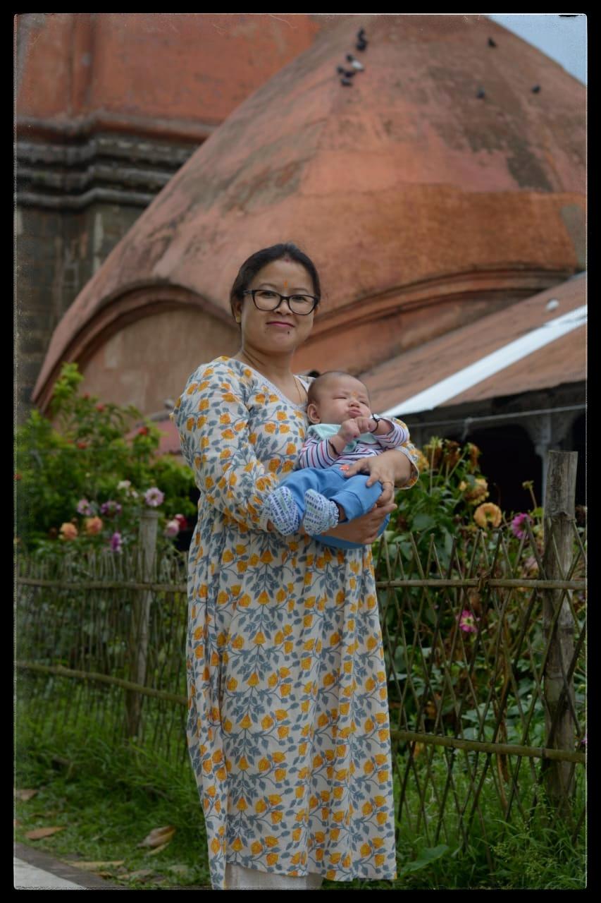 Pallabita Bora and her son, Nevaan in front of Shiva Dol Sivasagar Assam