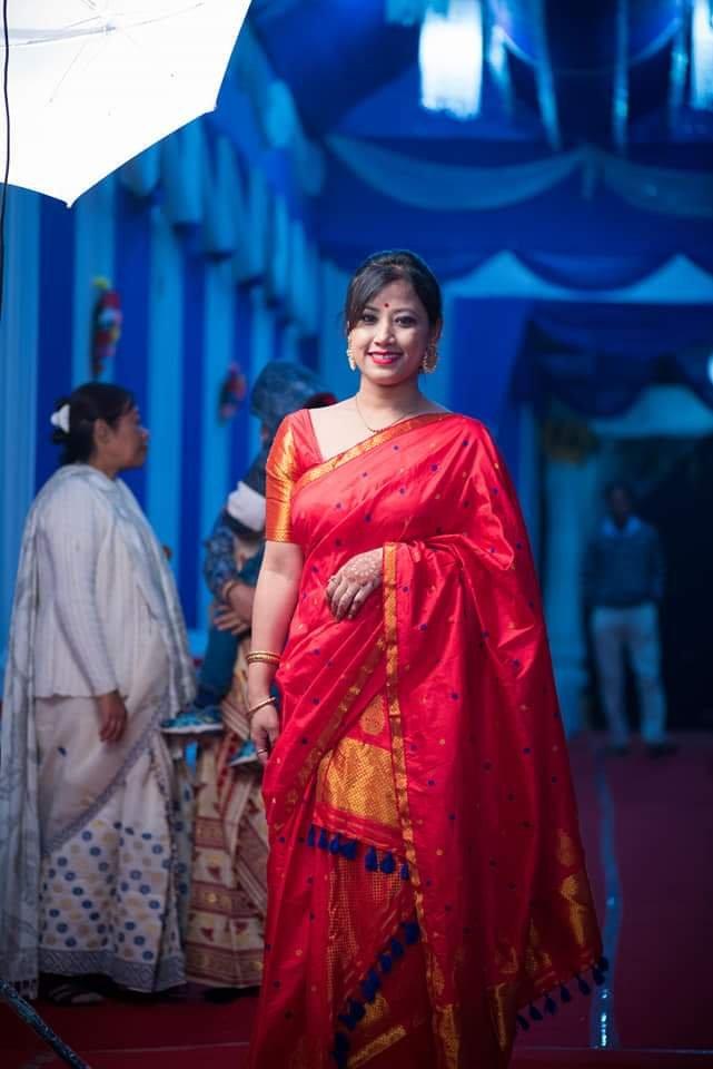 Assamese lady wearing red Paat Mekhela Sador