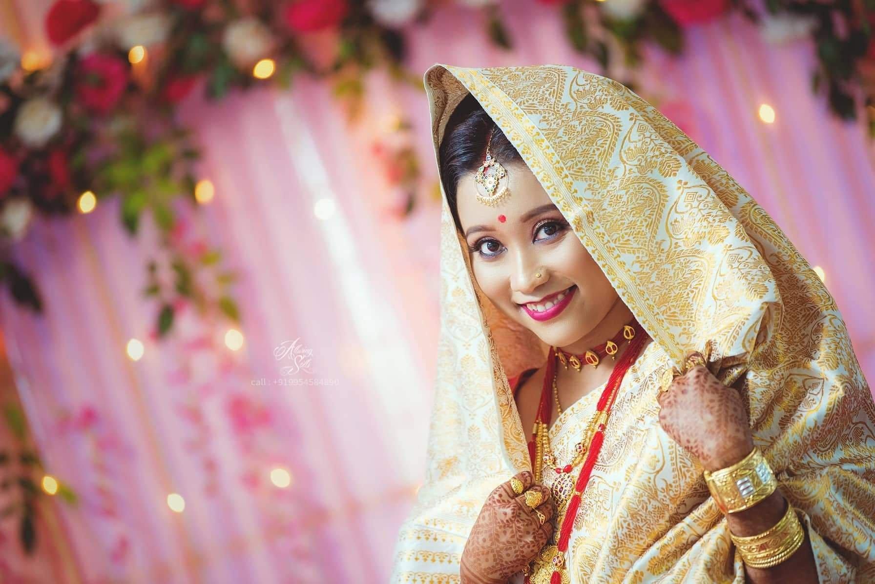 Assamese bride flaunting the ceremonial white paat mekhela chador