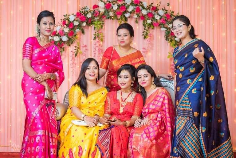 Assamese girls flaunting colourful paat mekhela sador saree
