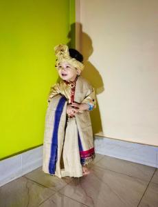 Ahom dress worn by a child